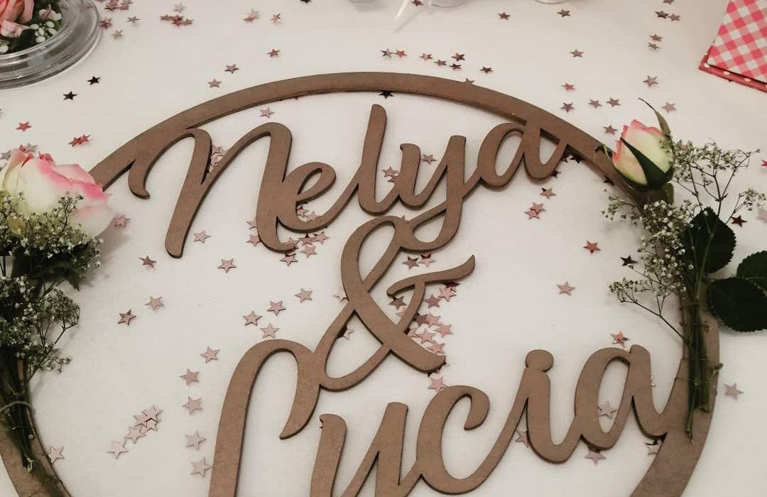 Photographie sur table du baptême de Nélya et Lycia